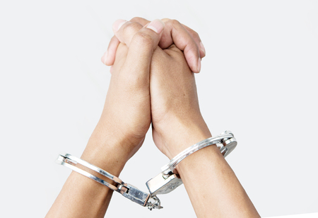 close up hand with shackle on white background Stock Photo