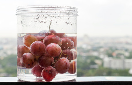 safty: close up grape fruite water for soak and clean for health safty Stock Photo