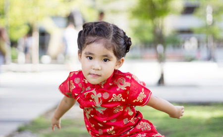 close up asian Chinese girl in red dress action funny Stock Photo