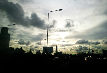 strom: silhouette golden sunset on express way road in cloud sky like strom in bangkok Thailand Stock Photo