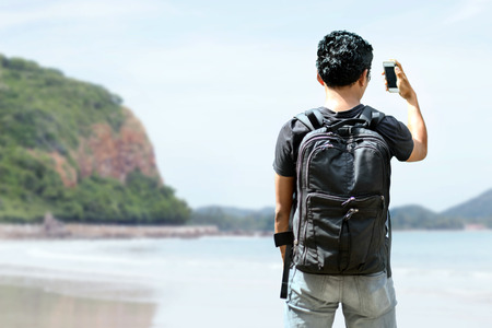 new generation: new generation young traveler use mobile for find destination to sea