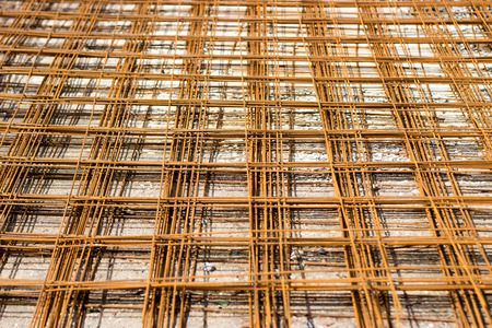strenghten: rusty steel road net bar used to reinforce inside concrete for construction building