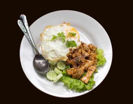 favorite thai food grill pork with garlic and pepper with fry egg on rice menu Stock Photo
