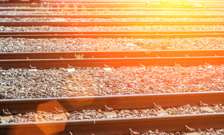 iron railway in sunset lightime for background