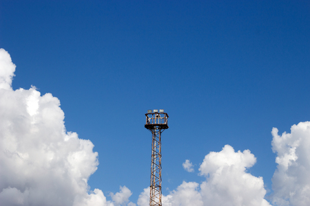 high tower emergency spot light for train signal on clear sky for background Stock Photo