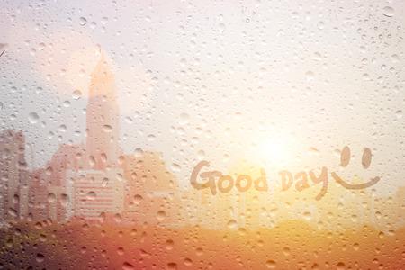 draw good day word on raining window for encorage inside myself get up in morning Reklamní fotografie
