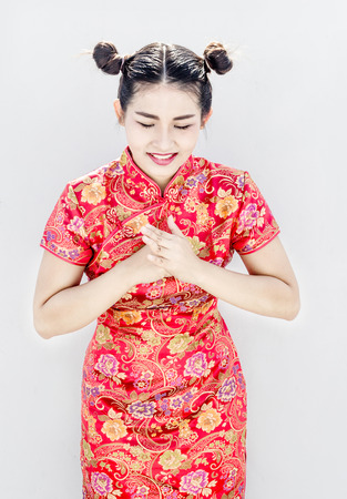 asian chinese in red qipao cheongsam suite point to camera potrait respect action