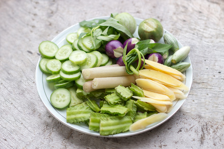 mix asian thai herb vegetable on dish cucumber lotus eggplant  winged ginger and morning glorry