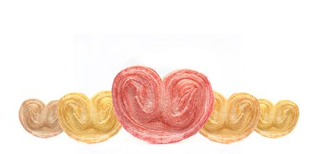 crispy heart or buterfly or elephene ear bakery on white background for valentine Stock Photo