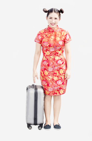 asian thai chinese woman in traditional qipoa dress with travel bag as tourism on gray background