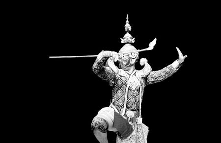 dramatic characters: asian and Thailand traditional performance drama call ramayana in giant suite on black isolate background
