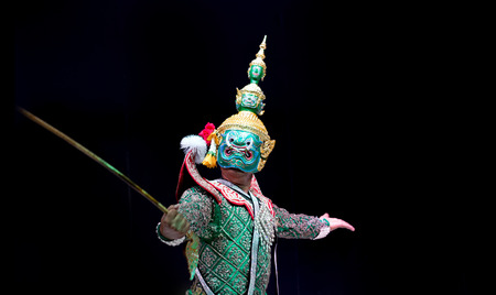 asian and Thailand traditional performance drama call ramayana in giant suite on black isolate background