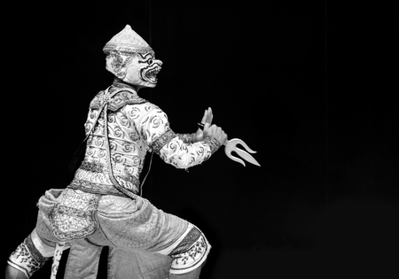 pantomima: asian and Thailand traditional performance drama call ramayana in monkey suite on black isolate background