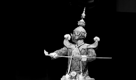 pantomima: asian and Thailand traditional performance drama call ramayana in giant suite on black isolate background