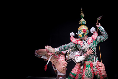 dramatic characters: asian and Thailand traditional performance drama call ramayana in giant and monkey suite on black isolate background