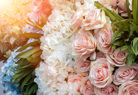 polen: mix artificial flower bush rose yebira daisy for decoration in flare light background