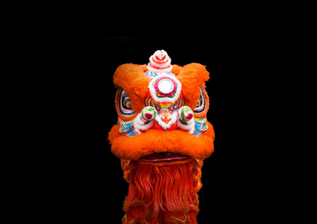 lion head dancer performance Chinese style for show in cerebrate China new year festival in black isolate background