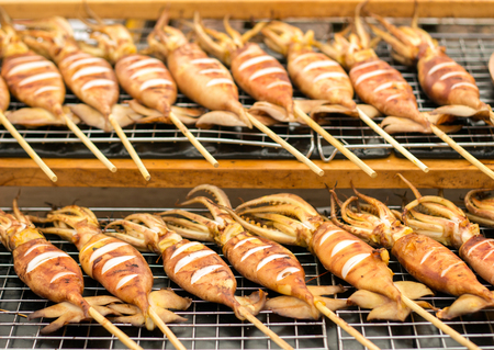 select focus roast squide barbeque with wood stick street food