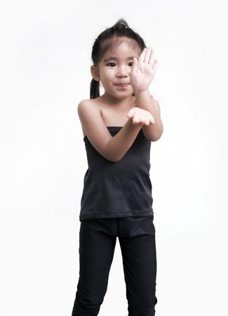 smiling asian girl do yoga action on matt in power position Stock Photo