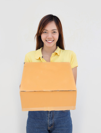 recive: asian lady hold paper box package and smile on white background