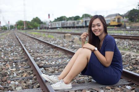 portrait street photo shot of asian lady at old railway  in fashion concept Stock Photo