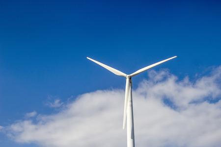 wind turbine on blue sky background Stock Photo