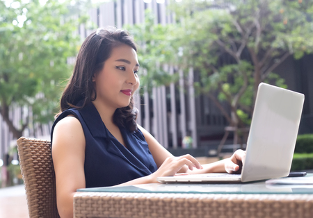 happy asian woman work from home with laptop and wireless conneting by technology