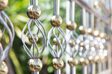 close up decoration fence from alloy in gold and silver colour