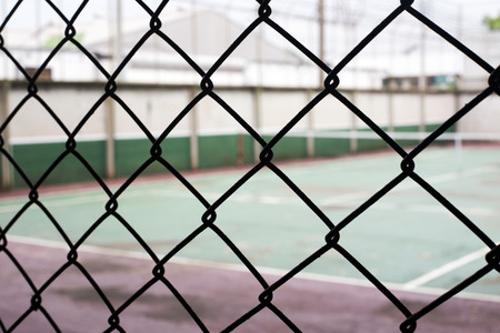 focus silhouette net with blur old tennis court for sport game Stock Photo