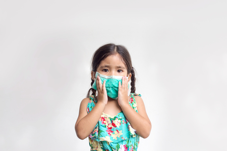 asian girl close up her mouth and nose with hygine mask for protectpolution  Banco de Imagens