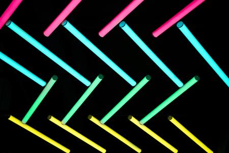 color neon ligh bulb in dark background