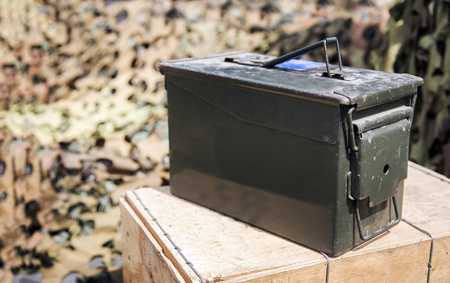 dark green steel box in military concept for collect bullet or weapon on soldier bunker background Stock Photo