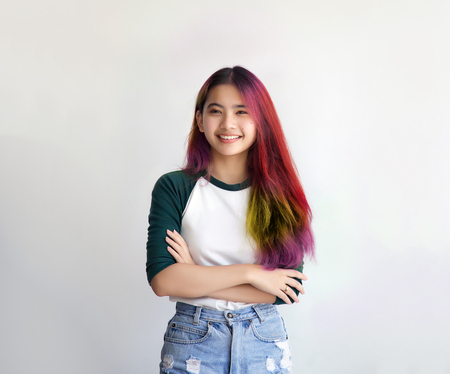 pretty asian femele smiling joyfully with colorful hair in dressed casually like hipster lifestyle, Independent fashion concept. Stock Photo