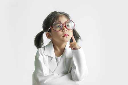 asian girl with big glass and science suite action on white screen. Thinkig to solvproblem action kid model with doctor or science costume.
