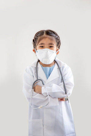 asian kids with air polution protect mask and stethoscope with  doctor suite costume. Portrait action as block smoke smell on blue background (include clipping path)