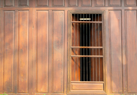 old vintage exterior window and wall with wood and iron in Thai style Foto de archivo