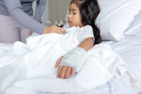 heal Influenza A virus or H1N1 flu asian kid on hospital bed. Medicine virus situation when kid have high fever,