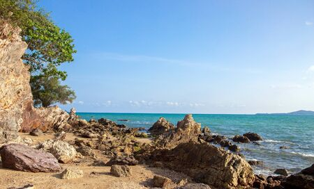 nature island seascape rock on beach tropical ocean summer scenic. Beauty in nature background concept