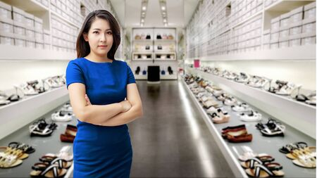 Confidence asian woman good looking in shoes shop