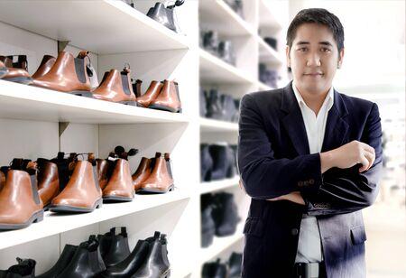smart asian businessman choose leather shoe shop for good looking.
