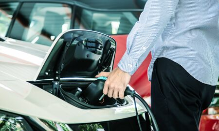 hand hold charger electric vinhicle car for power at station to technology of car Reklamní fotografie