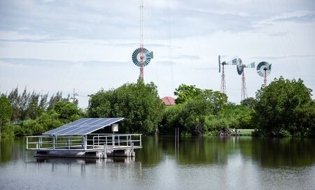 green electrict power with solar cell and wind turbine for generate power on water pond