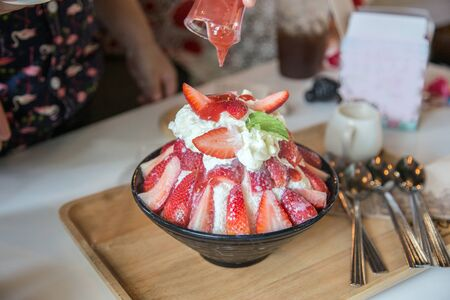 strawbery dessert with icing milk with strawberry sauce serve for sweet day 写真素材 - 132049704