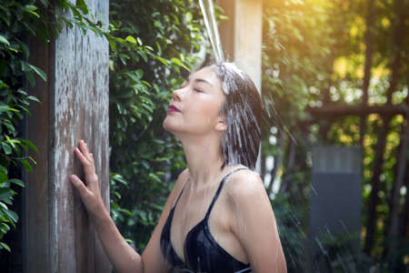 asian woman happy to shower outdoor activities after swim for good healthy Zdjęcie Seryjne
