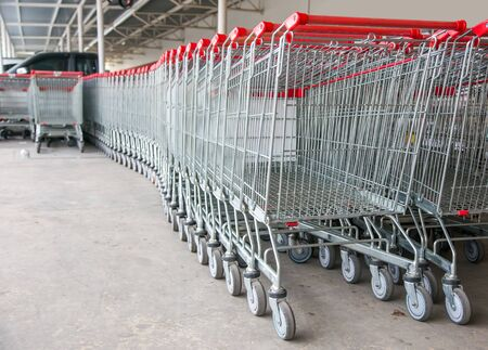 empty shopping trolley cart in supermarket cause shopping online and e-commurce is new normal of customer behavior