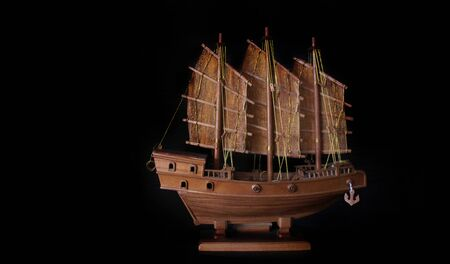 handmade barque boat from wood for decoration Chinise home on black background
