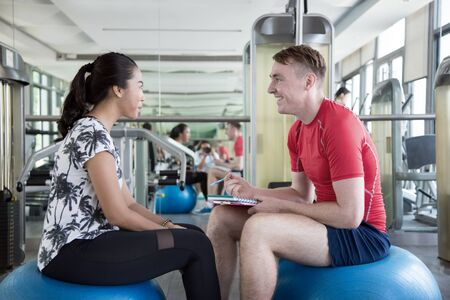 personal trainner of sport gym to assistance and suppport to good health