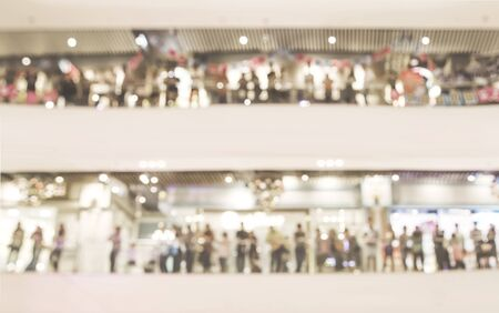 abstract blur people crown cherring at modern trade center with two floor for background