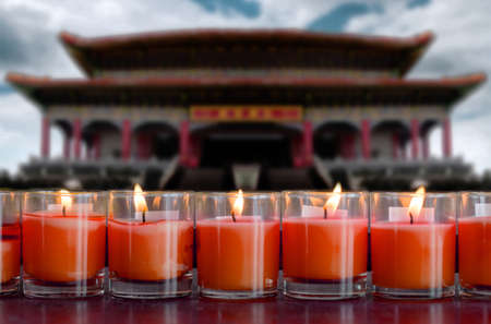 praying and meditation with burning candle on Chinese temple in new year festival of Chinese race. Zdjęcie Seryjne