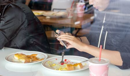 take photo with mopbile to social network post before eat is new behavior of customer